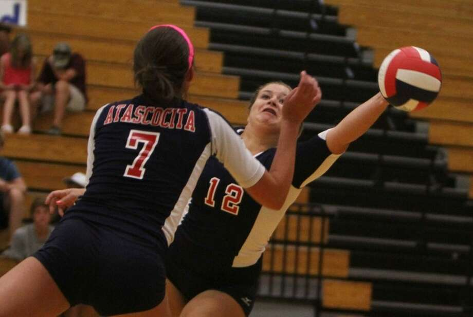 Kirby Jullian (12) attempts to save the ball during high school volleyball game between Atascocita and Klein Oak Sept. 4 at Atascocita High School. Photo: Photo By Jason Fochtman