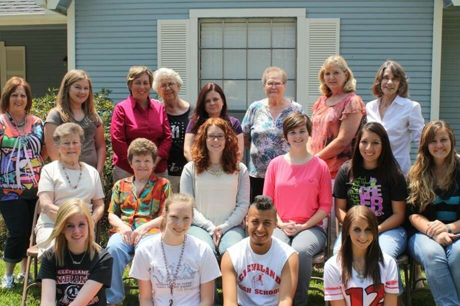Cleveland ISD cheerleaders and band recently partnered with Laverne's Angels to advocate for foster care children. Shown left to right are (front row) Lacy Wilkins, Katie Burkett, Mario Gonzalez, Sonya Mize; (middle row) Billie Jean Evans, Laverne Keen, Jennifer Littrell, Sara White, Abigail Pesina, Lauren Hoffschneider; (back row) Cathy Winkle, Alicia Diosdado, Kristy Jones, Betty Bell, Misty Copeland, Bobbie Wilson, Marilyn Gilliland and Helen Green. Photo: STACEY GATLIN