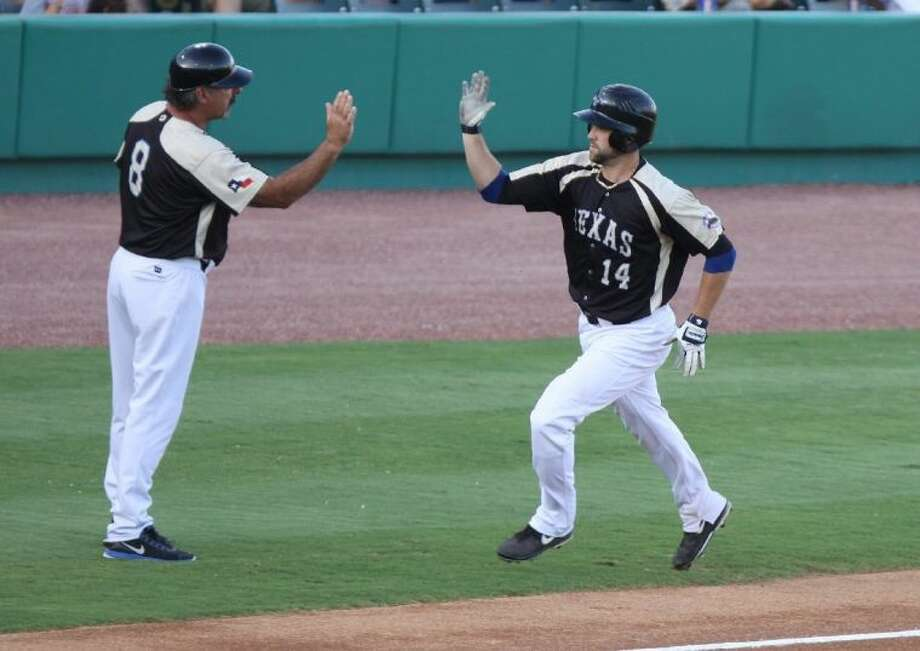 Sugar Land Skeeters' Reid Gorecki gets gets a high five from manager Gary Gaetti after hitting a two-run home run June 28 against the Southern Maryland Blue Crabs at Constellation Field. The Skeeters won the game 8-7 in the bottom of the ninth and clinched the Atlantic League Freedom Division first-half title the following night.