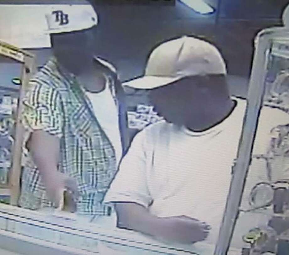 """Deputies are searching for a third suspect (right) involved in a northwest Houston jewelry store burglary. Heis described as a black male, heavy set, 5' 3"""" tall, between the ages of 35 and 40. Photo: From HCSO"""