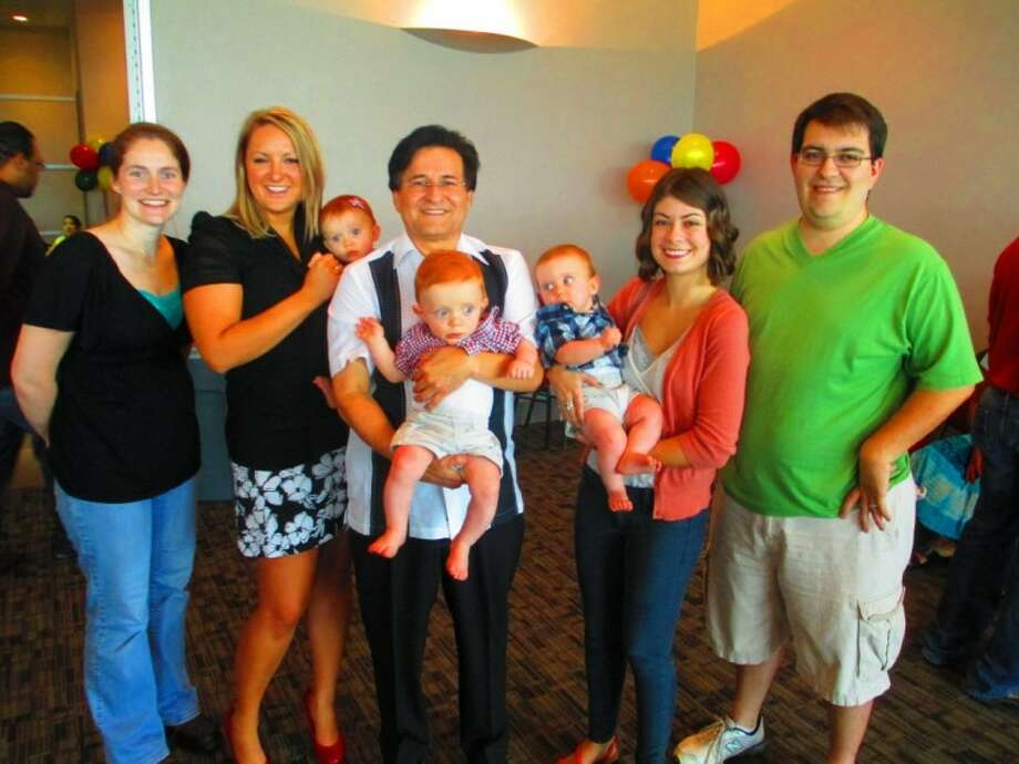 Stephanie, far left and Ricky Layton, far right; brought their triplets back to Memorial Hermann Northeast's 18th annual NICU reunion to visit Neonatologist Angel Munoz. Pictured from left are: Stephanie Layton; NICU Nurse Julie Gonsior holding Cheyenne; Dr. Angel Munoz, holding Luke; NICU Nurse Kylee Giannullo holding Elijah; and Ricky Layton.