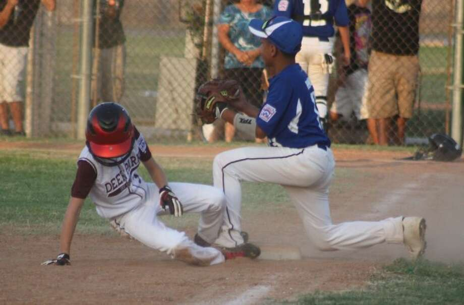 Deer Park 12-year-old all-star Brandon Dunn slides safely into third base during the Jacinto City game. Dunn did his part to give a 12s all-star team from Deer Park Little League its most victories in the tournament since 2005. Photo: ROBERT AVERY