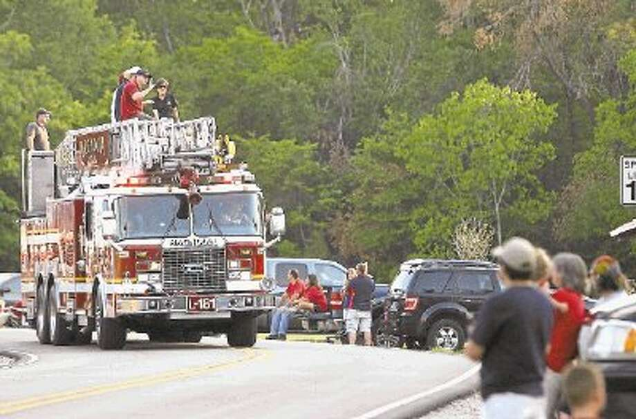 A Magnolia Fire Department fire truck leads the parade during a Fourth of July Celebration at Unity Park in Magnolia in this Potpourri file photo. Photo: Eric S. Swist / @WireImgId=2632155