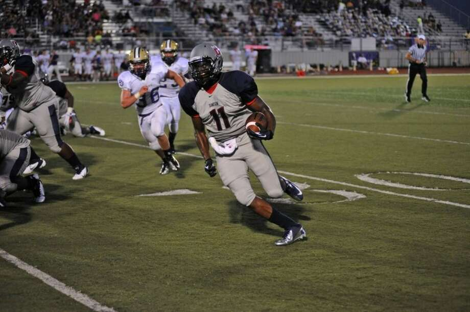 Dawson's Tony Upchurch (11) turns the corner and heads down field against Montgomery in the first half of the Eagles' season-opening win. Photo: KIRK SIDES
