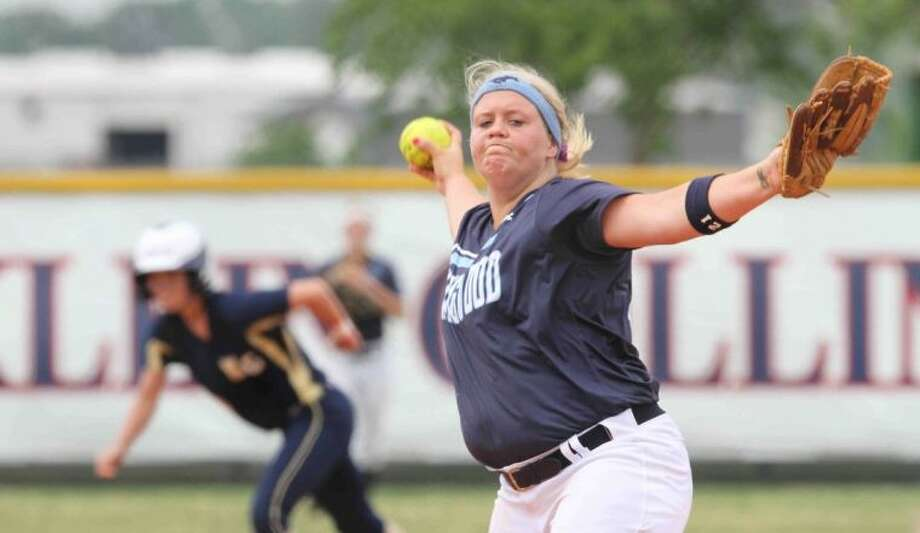 Kingwood's Cassie McClure pitches during a high school softball playoff game against Klein Collins at Klein Collins High School on Friday, May 10, 2013. McClure was recently named to the Texas Girls Coaches Association all-star game 4A-5A Blue team. Photo: Jason Fochtman