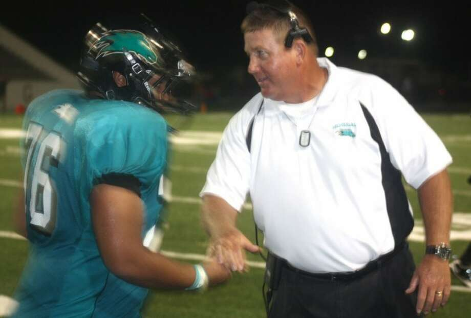 Mavs head football coach Chris Quillian greets offensive lineman Jordan Stephens back to the sidelines after the team's victory-clinching touchdown pass with 1:59 remaining Thursday night. Photo: ROBERT AVERY