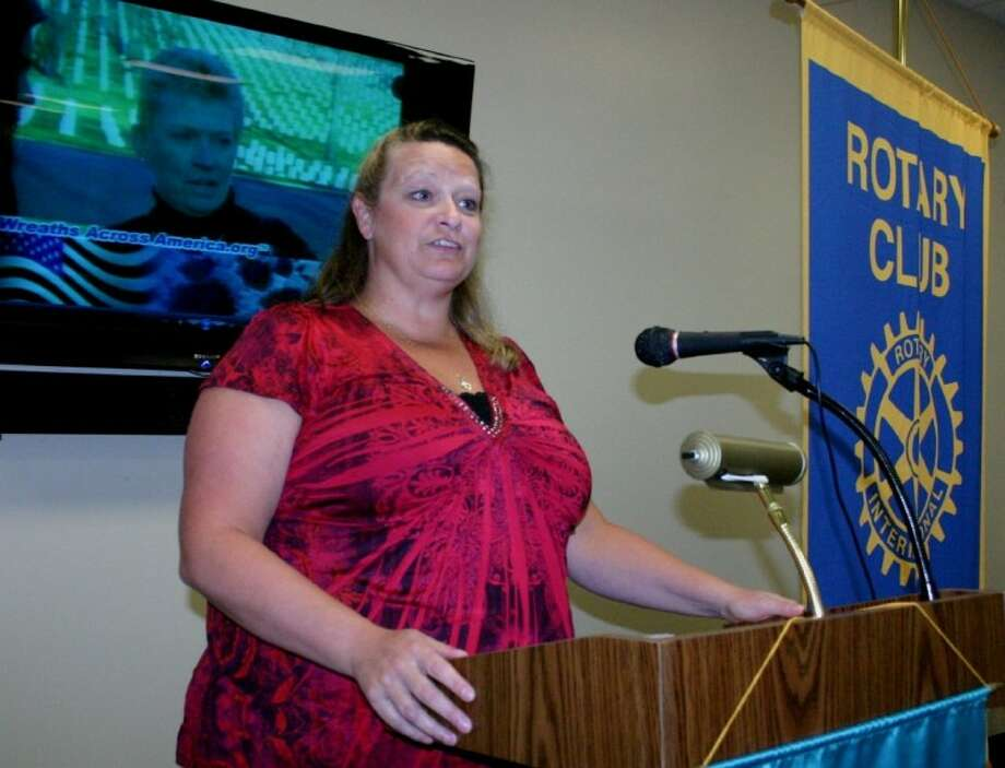 Samantha Jameson, with Kingwood-based Wreaths Across America-Houston, discusses the 501(c)(3) organization as guest speaker at the Dayton Rotary Club Luncheon held Sept. 6 at the Dayton Community Center. Photo: STEPHEN THOMAS