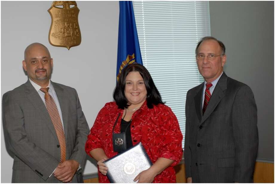 Pictured are FBI Houston Special Agent in Charge Stephen L. Morris, Pct. 4 Deputy Constable Christina Coronado and U.S. Attorney (Southern District) Kenneth Magidson. Photo: Submitted