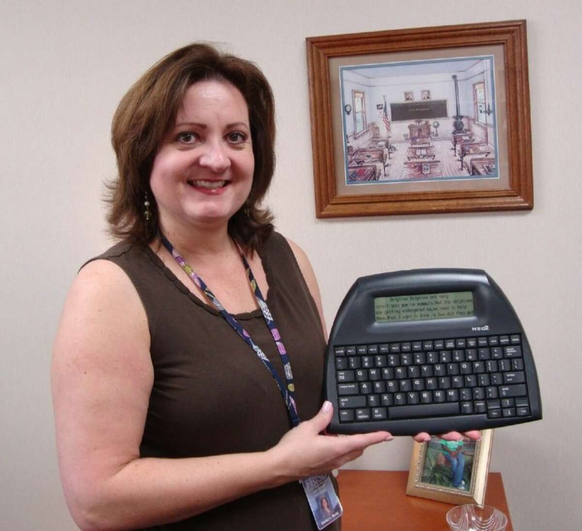 Jan Schiff Elementary first-grade teacher Christina Murat presents one of the NEO 2 wireless keyboards now used by students at the school. The school is the first in Fort Bend ISD to use the teaching technology.