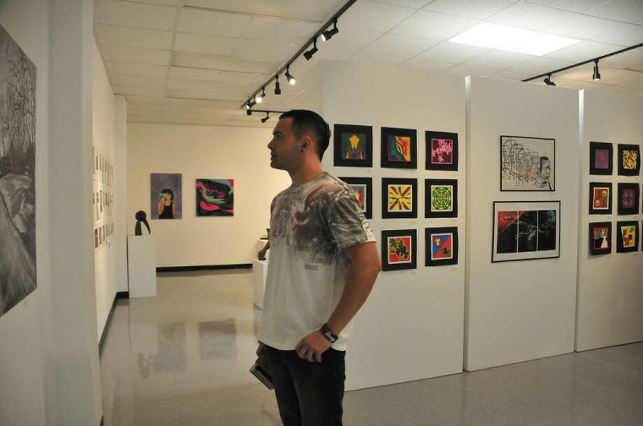 San Jacinto College art student Michael James stops by a Juried Student Exhibition at the Central Campus art gallery. Photo credit: Jeannie Peng-Armao, San Jacinto College marketing department