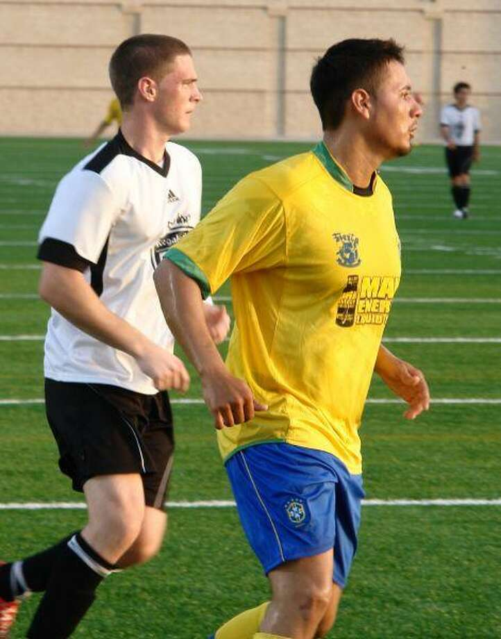 CPHS grad Josh Lahr, in white, is one of three local Regals FC players.