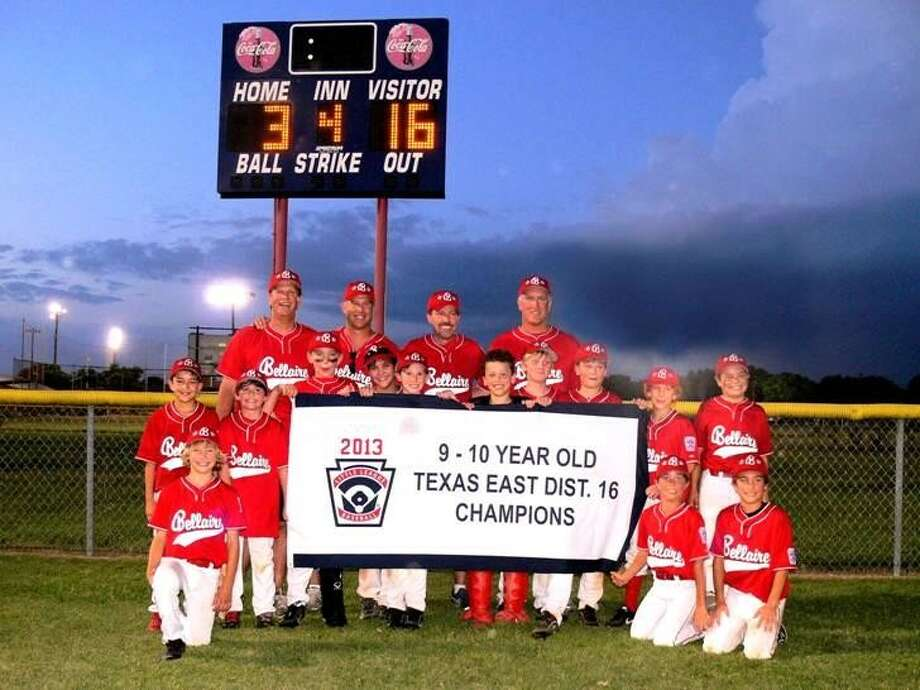 The Bellaire 10 year-old Little League all-stars recently won the District 16 Little League Championship and they hold their banner as the final score of their last game in the tournament shines on the scoreboard behind them. In front, kneeling from the left, Garrett Loughhead, Kai Rubenstein, and Peter Joseph Corbett. Middle row: Mark Richards, Brett Bazarsky, Parker Smith, Jacob Roubein, Grant Stringer, Jack Ben-Shoshan, George Mills, Tanner Fox, Aidan Via, and Jacob Dixon. Standing in the back: Coach Mike Fox, Coach Rob Via, Manager Kevin Richards, and Coach Peter Corbett.