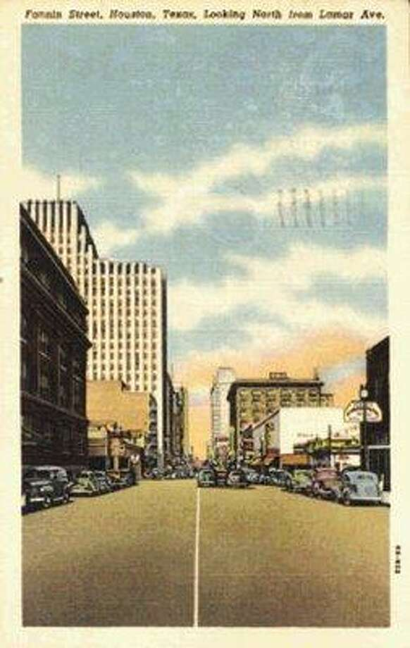 This postcard of the area of Fannin and Lamar in 1952 Houston is a part of the 'History of Postcards' display now at The Heritage Society Museum. / @WireImgId=1432860