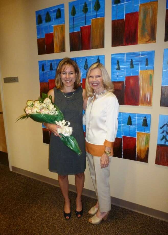 Dr. Ann Snyder, right, president and CEO of Interfaith of The Woodlands, announces that St. Luke's The Woodlands Hospital has been named a 2012 Hometown Hero to Debra F. Sukin, senior vice president, St. Luke's Episcopal Health System, and CEO for SLWH and St. Luke's Lakeside Hospital.