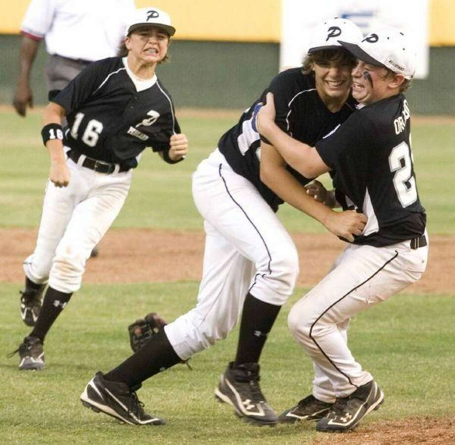 Pearland's Pryce Beshoory (16) Mason Van Noort (33) and Beau Orlando celebrate after defeating Eagle Pass 5-3 during the Little League Southwestern Region Championship game at Norcross Stadium in Waco on Thursday evening. / Patric Schneider