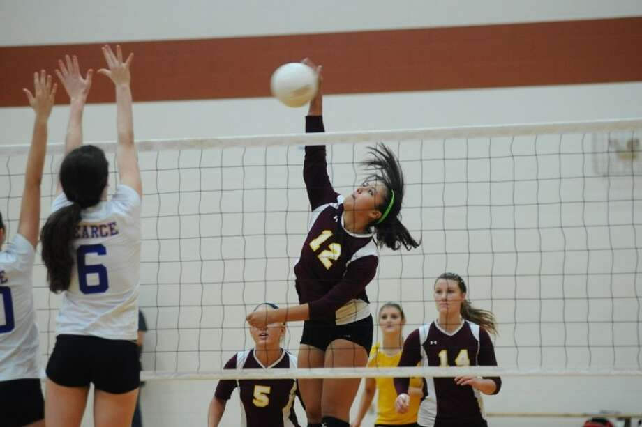 Deer Park's Bethany Covington (12) hits a kill shot at the net during the Nike Volleyball Classic in Pearland Thursday, Aug. 30.