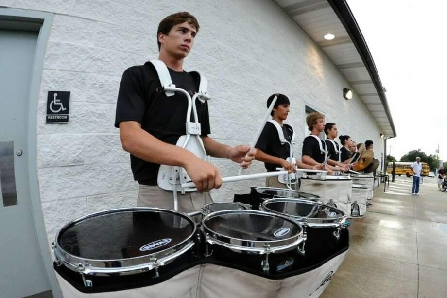 The Clear Creek drum corp performs as the band marches in before the game against Ridge Point Saturday, Sep. 1. Photo: KIRK SIDES