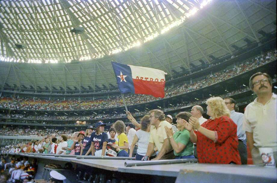 Surrounded by a ring of spectator seats, the Dome was the biggest theater in town. In this photo: Astros fans celebrate after the team clinches the NL West title in 1986. Photo: Tim Bullard, Houston Chronicle