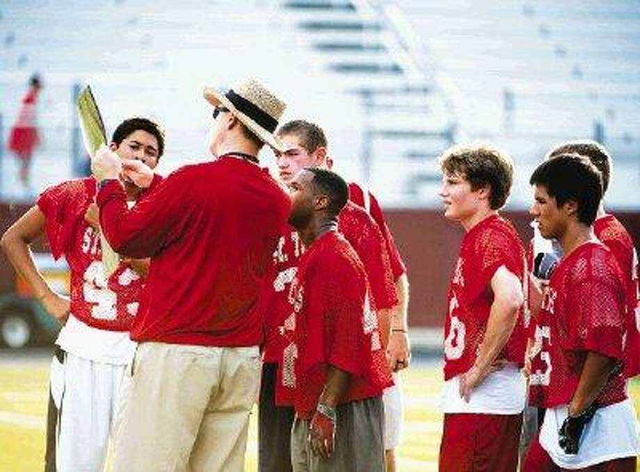 The St. Thomas football team, shown here reviewing a play during 7-on-7 summer league action, are looking to again reach the TAPPS 5A playoffs. / ©2010 Gulf Coast Shots. All rights reserved.