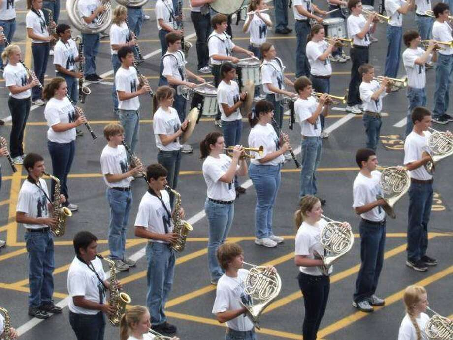 The Kingwood Mighty Mustang Military Marching Band prepares for marching season. The band will travel to New York City in the spring.