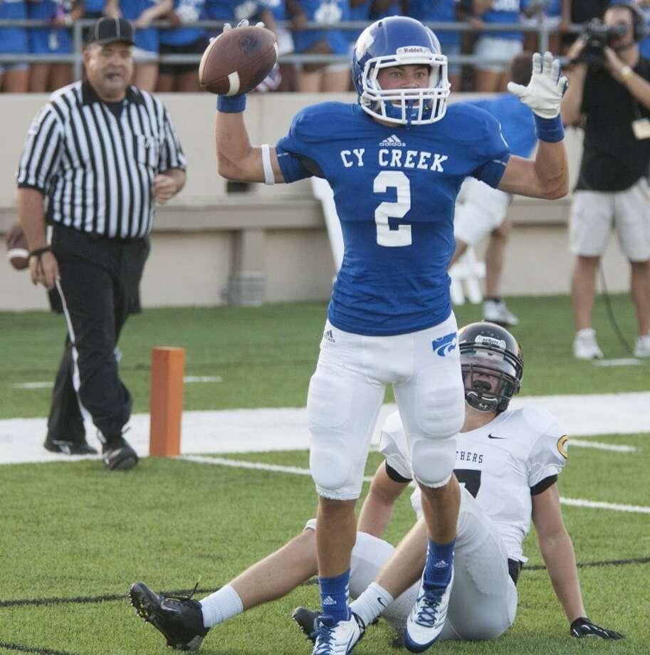 Cy Creek's Kyle Huffscores a touchdown against Klein Oak on Friday at Ken Pridgeon Stadium. Cy Creek is No. 4 in the power rankings this week after the big win. Photo: Karl Anderson
