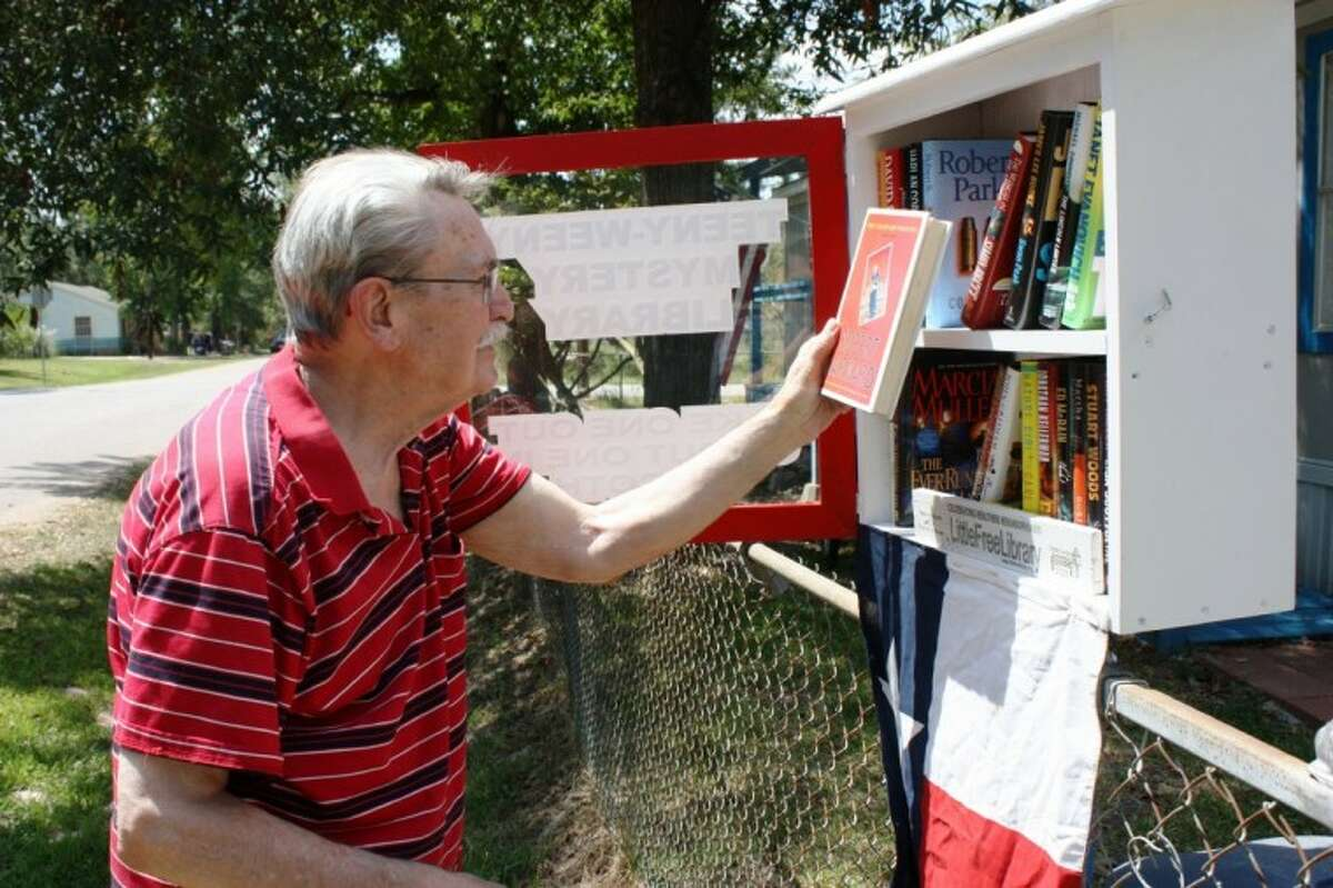 Joe Parsons demonstrates his Little Free Library located at 220 Hardin in Cleveland. The little library allows anyone to get a book for free and leave a book for others.