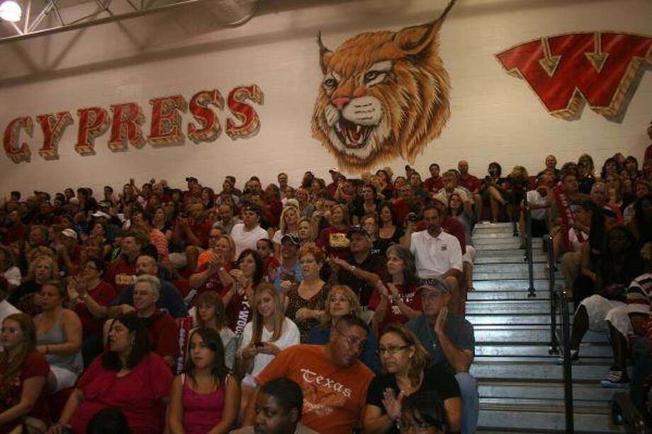 Cy Woods High fans enjoy the pep rally in the school gymnasium before the Midnight Practice event. (Photo by MICHAEL SUDHALTER/The Sun)