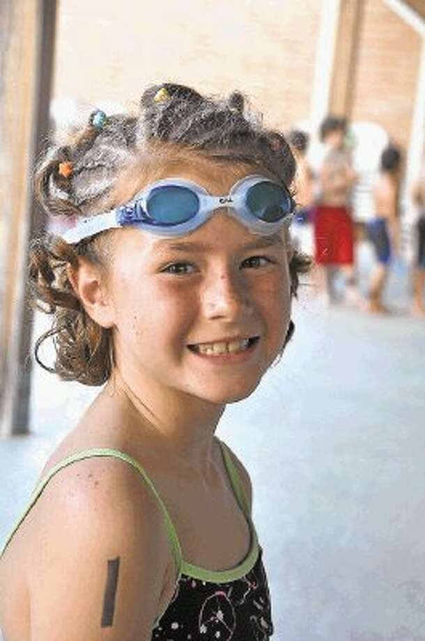 Rebecca Barrows of The Woodlands participating in a recent Kids Triathlon. / @WireImgId=2632399