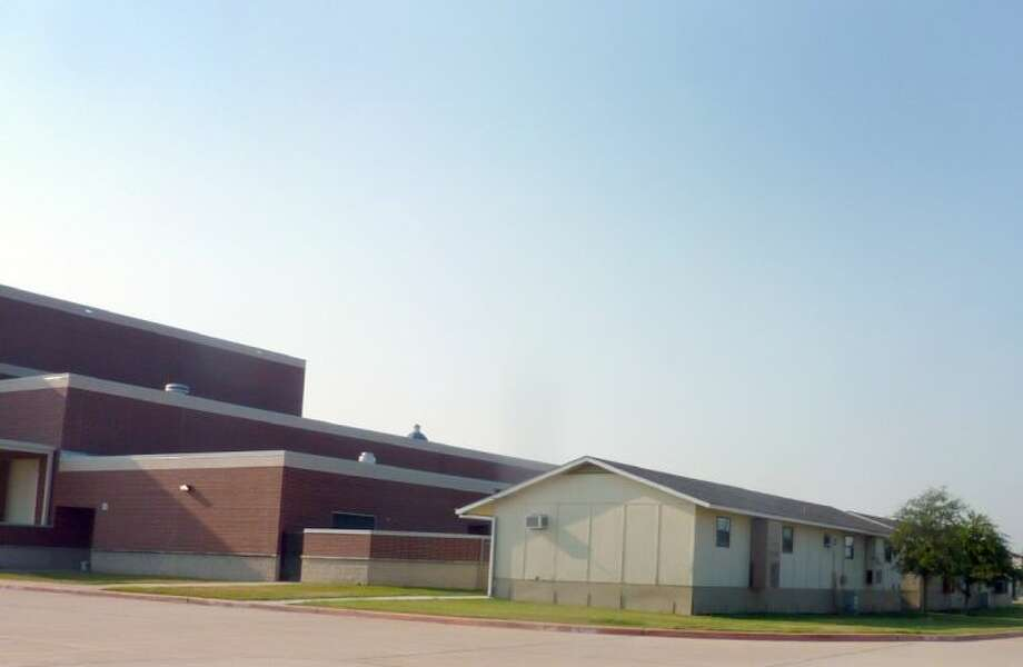 Dawson High School is expected to reach 96 percent capacity next year with a projected enrollment of 2,160 students. Two portable buildings are currently parked behind the main campus to help meet the school's demand for overflow classroom space. Photo: KRISTI NIX