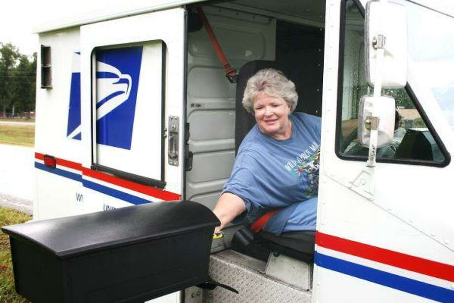 Rural mail carrier Kathy Planter delivers her mail with a smile, says those who are her customers. The carrier was honored last Friday with a membership in the National Council on Safety's Million Mile Club for her 30-plus years of accident free delivery.