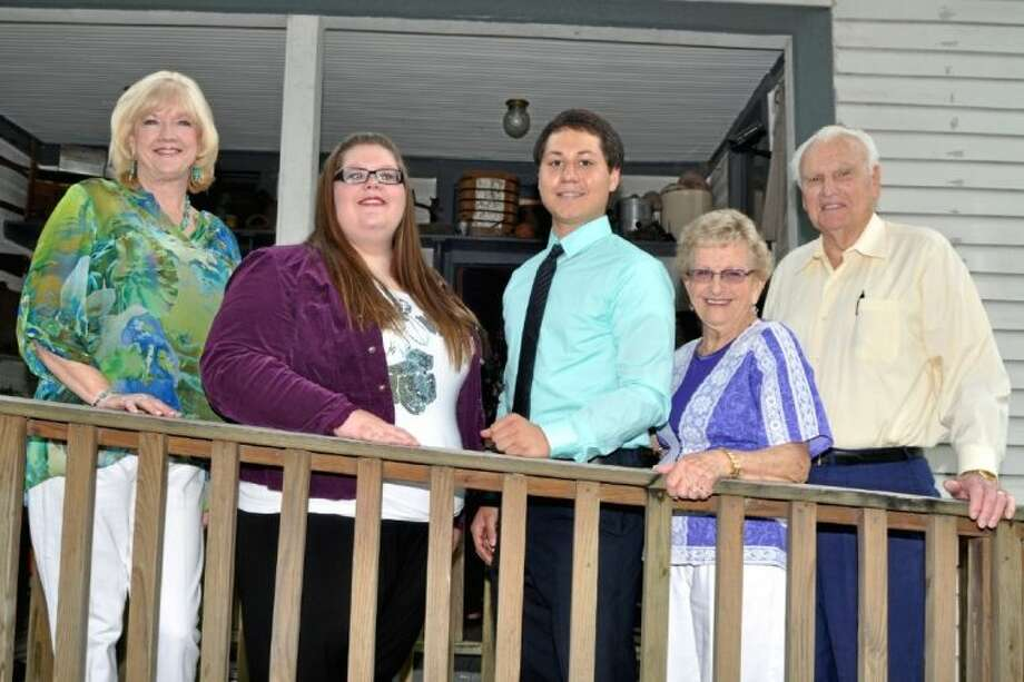 Standing on the back porch of the Pomeroy House pictured from left are Carol Arnold, President of the Historical Society, Marcy Higginbotham and Benjamin Salazar, Scholarships recipients, Edna Pierce, Heritage Park Manager and E.J. Ritchey, Scholarship Chairman. Photo: JACKIE WELCH