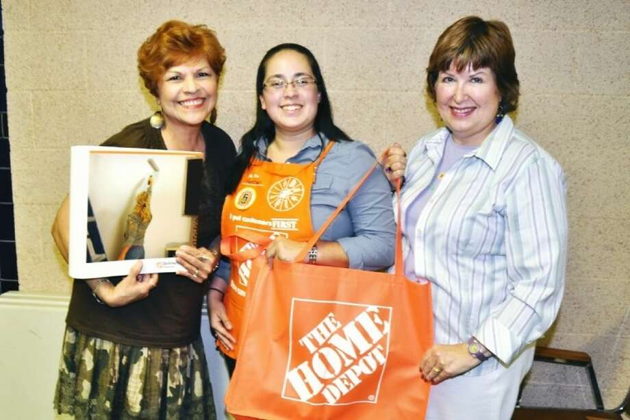 """Showing off some of the Home Depot """"give-a-ways"""" at the Queens Neighborhood meeting are (from left) Jenna Lobb, President of QNA, speaker Amber Clark, Operations Assistant Store Manager at Pasadena's Home Depot and Myra Johnson, Community Care Officer of QNA. Photo: JACKIE WELCH"""