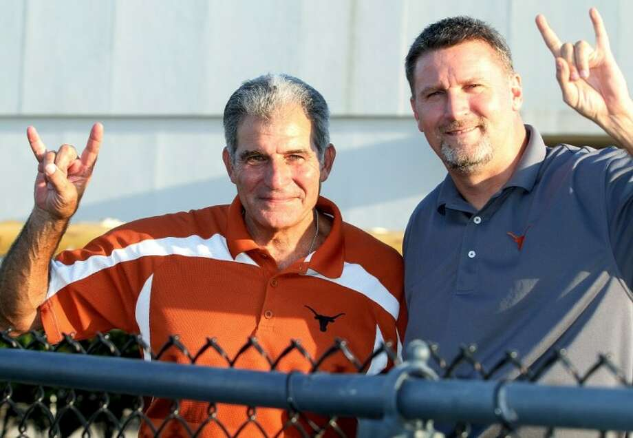 Former Dobie principal Steve Jamail (left) with current Principal Franklin Moses at a recent Longhorns football game. Photo: AL CARTER