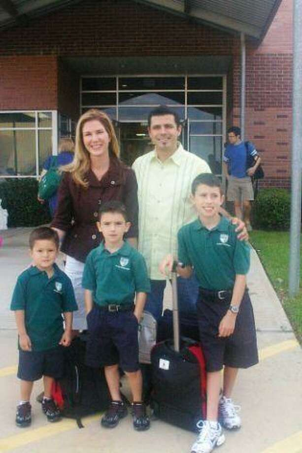 The Pesquera Family on the first day of school at St. Anne. Maeve and Luis and their children Diego (Pre-Kindergarten), Aidan (1st Grade) and Leo (4th Grade) were one of the first families to arrive on Thursday morning.