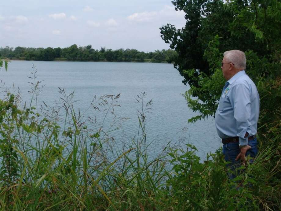 """Friendswood City Councilmember Jim Hill at Friendswood Lake. Council voted Monday night (with Mayor Kevin Holland and Hill dissenting) to take $380,000 from the 90-day city reserve fund, add Parks Dedication Ordinance money and """"earmark it"""" to develop Lake Friendswood after feedback from nearby residents is considered and brought back to council. Photo: JEFF NEWPHER"""