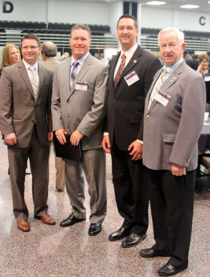 The Economic Alliance Houston Port Region hosted the Petrochemical Maritime Outlook Conference Thursday (Sept. 6) at the Pasadena Convention Center. From left: Ken Phelps, Executive Board Member of the Economic Alliance Port Region, Chad Burke, President and CEO of the Economic Alliance Houston Port Region, 2012 Petrochemical Maritime Outlook Conference Committee Member, Pasadena City Councilmember Stephen Cote and Pearland Mayor Tom Reid. Photo: KRISTI NIX