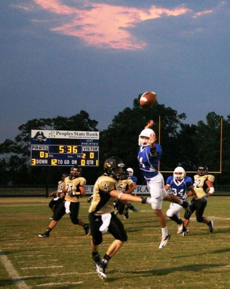 Shepherd's all-purpose player Cody Everitt leaps to break up a Woodville pass in visiting Woodville's 30-22 victory Sept. 7. The pass fell out of bounds.