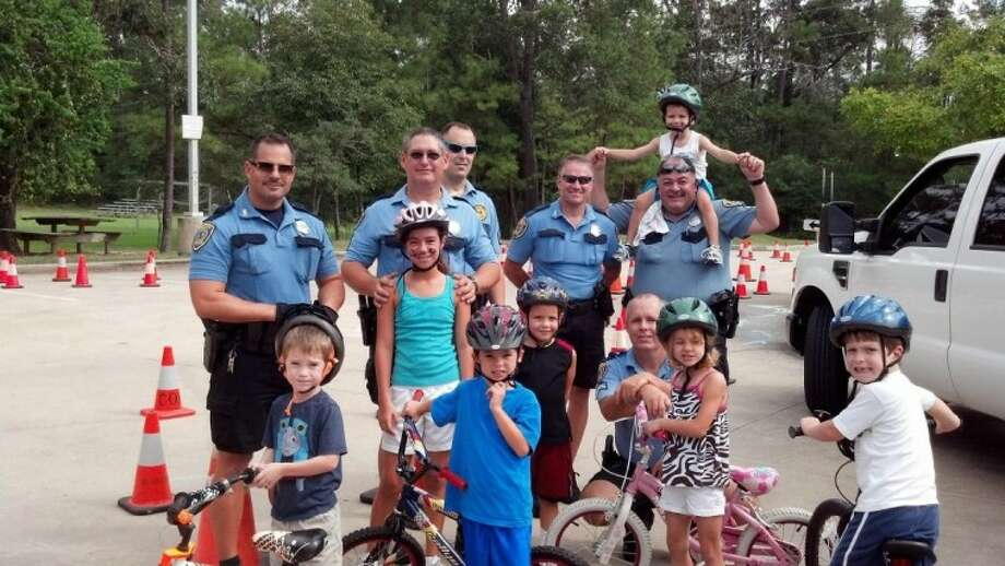 The Lake Houston Family YMCA and Houston Police Department bike patrol encouraged bike safety with a special event Sept. 8 where Memorial Hermann Northeast handed out free helmets to the first 250 kids.