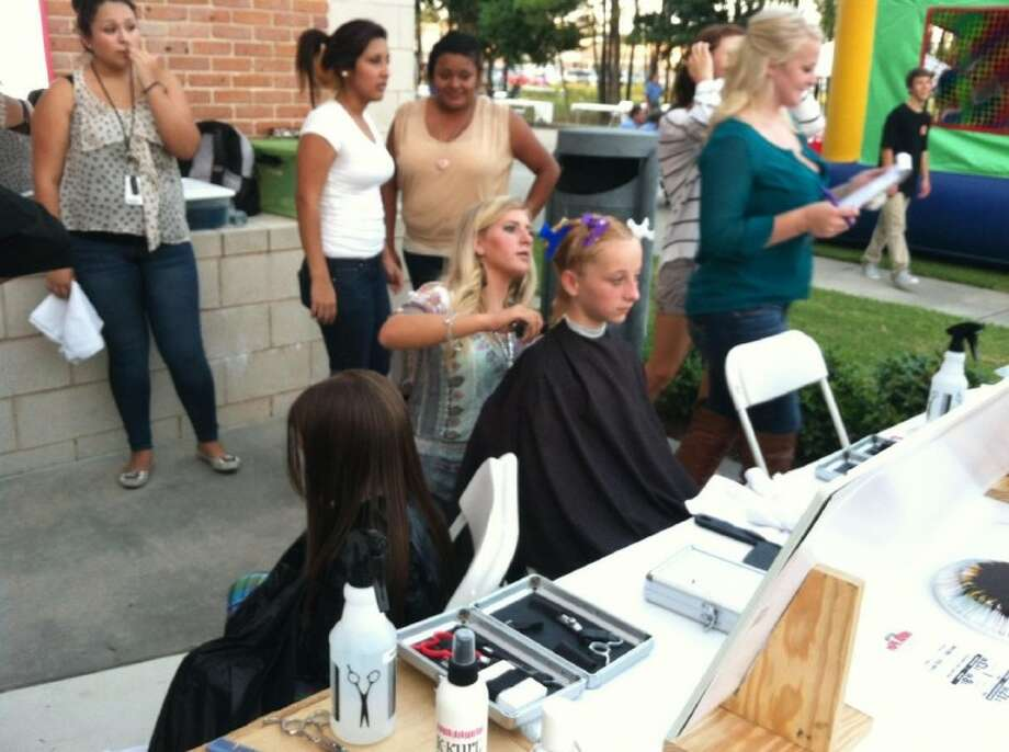 Cosmetology students from Porter High School provided free haircuts to practice their skills at the annual Back 2 School bash Sept. 6 hosted by the East Montgomery County Improvement District.