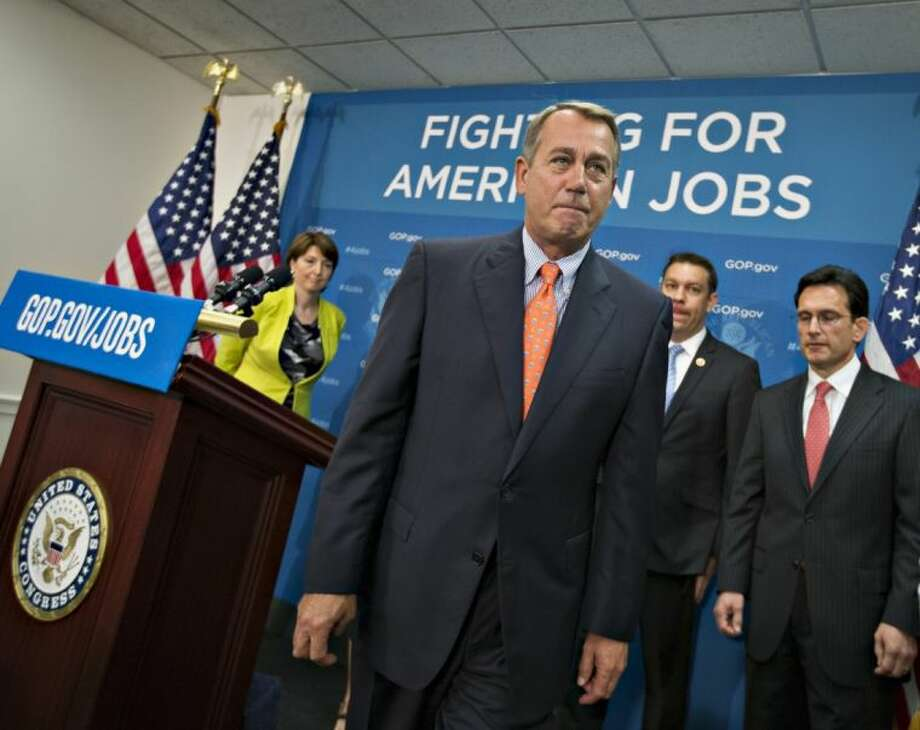 House Speaker John Boehner of Ohio, and GOP leaders, finish a news conference on Capitol Hill in Washington Tuesday following a Republican strategy session.