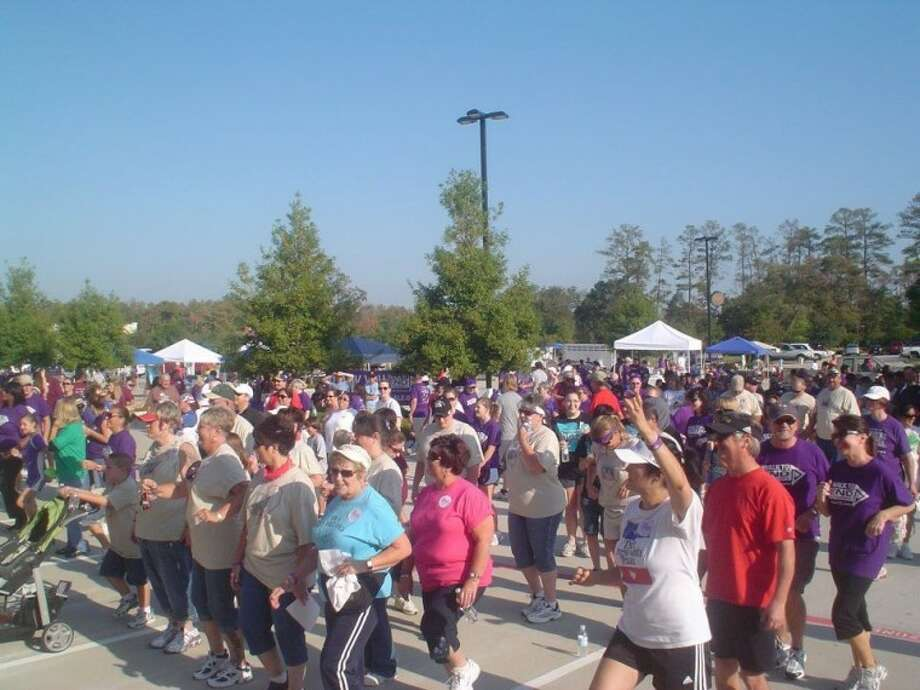More than 800 walkers warm up for last year's Walk to End Alzheimer's in northwest Houston.