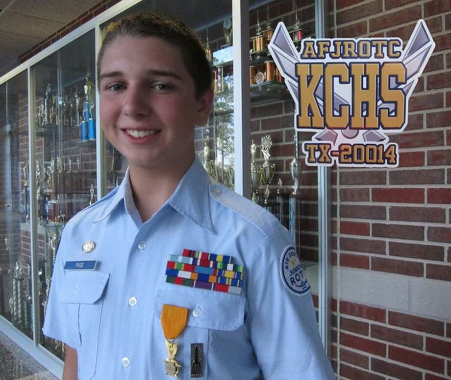 Collin Page received the AFJROTC Gold Valor Award from Colonel Daniel Crum.
