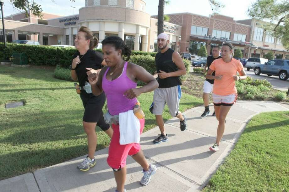 A group of runners start out on the Katy Social Run outside of Luke's Locker at LaCenterra in Katy. Photo: Photo By Alan Warren