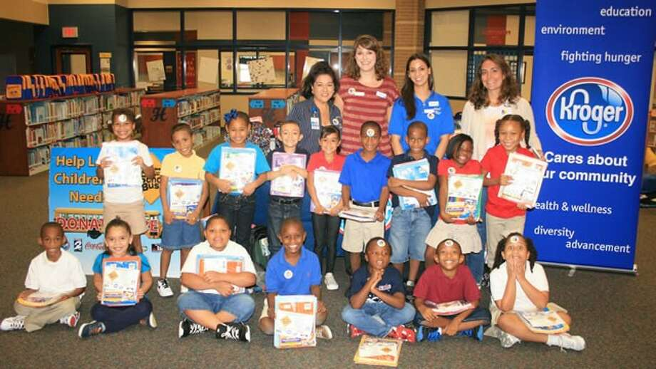 Second-grade students at Hoyland Elementary School show off their new school supplies, which were delivered recently by Kroger representatives. Front row, from left, are Brithney Medrano, Deshawn Marbley, Tyson Norman, Jerome Lewis, Josiah Jefferson-Lillie and Taylor Levi. Middle row, from left, are Makiya Bennettt, Kanye Butler, Kayla Gant, Jordan Estrada, Nathalie Espinosa, Anthony Davis, Damarcus Washington, Zi'Kyriah Walker and Phoenix Shelton. Back row, from left, are Cynthia Gomez, Hoyland principal; Katie Nock, Kroger community affairs; Melissa Rutledge, Kroger associate; and Niki Munoz, Hoyland second-grade teacher.