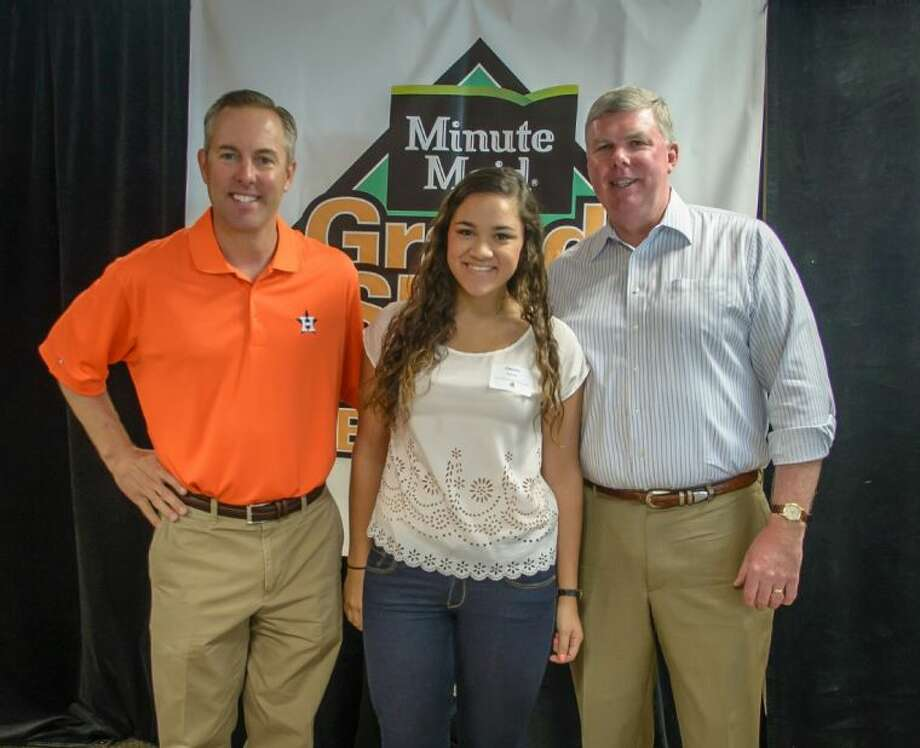Claudia Aguilar, a graduate of Foster High School in Richmond. She will be attending Texas State University. Pictured from left to right: Reid Ryan, President of the Houston Astros; Claudia Aguilar; and Mike Saint John, President of Minute Maid.