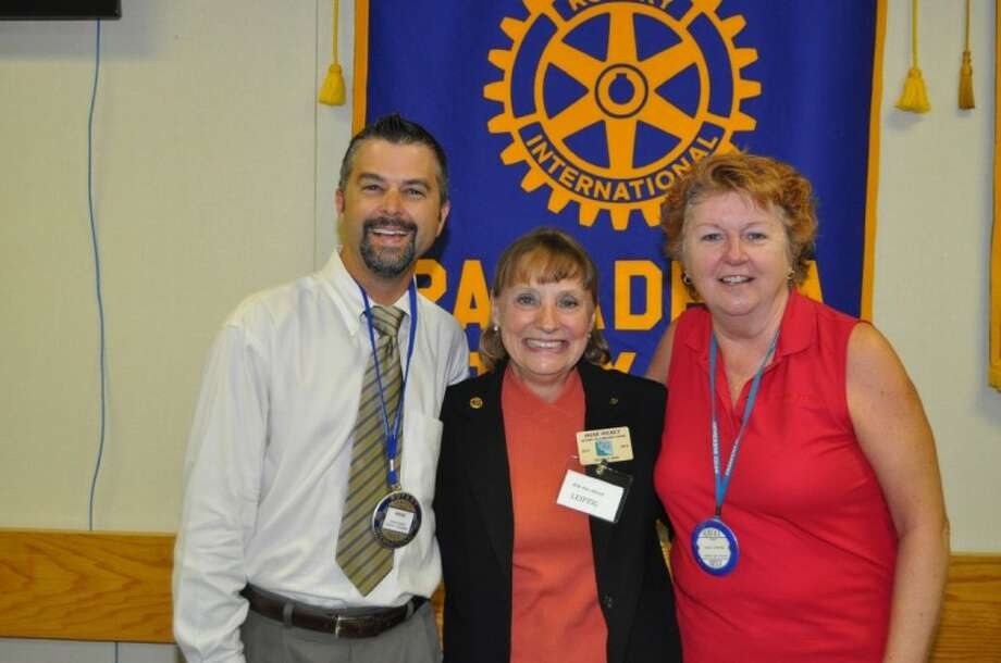 Pasadena program Chairman Brad French (left) and Pasadena Rotarian Karol Fletcher (right) greet Irene Hickey, the Public Relations Representative of the University Area Rotary Club and President -elect of that Club. Photo: BILL WELCH