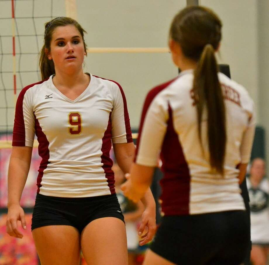 Summer Creek's Danielle Miller looks towards the bench in between points during the Lady Bulldogs' three-game sweep over Kingwood Park Sept. 7. Photo: Photo By Stephen Whitfield