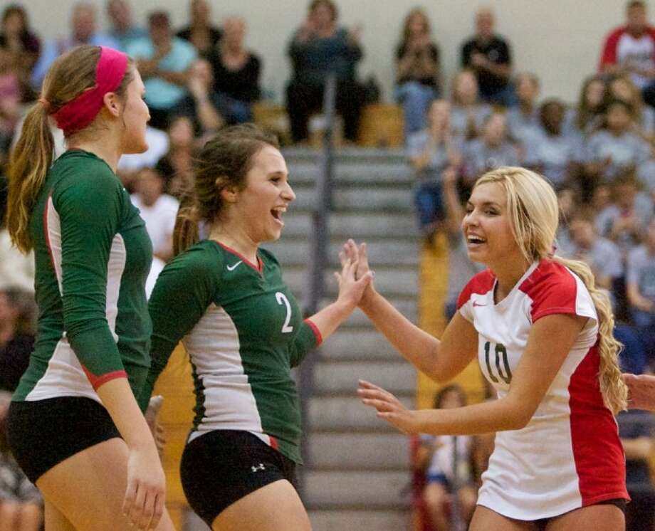 The Woodlands' Kelly Quinn celebrates a point with teammate Jordan Lee during a game against A&M Consolidated earlier this season. Photo: Staff Photo By Eric Swist