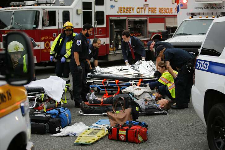 People are treated for their injuries outside after a NJ Transit train crashed in to the platform at Hoboken Terminal September 29, 2016 in Hoboken, New Jersey. Dozens are reported injured from the rush hour accident in the terminal that handles up to 50,000 passengers a day.