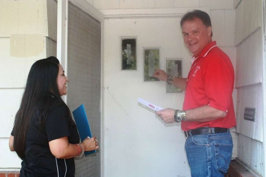 Superintendent Kerry Cowart and Asst. Superintendent of Curriculum Maria Silva knock on doors and encourage students to return to school. Photo: STACEY GATLIN